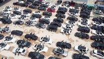 Kina: Odlagalište automobila potopljenih u poplavama